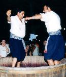 cyprus dancers stepping  on grapes during the Cyprus limassol wine festival